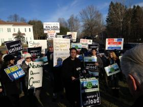 The Newtown Action Alliance rallies outside the Newtown offices of the National Shooting Sports Foundation.