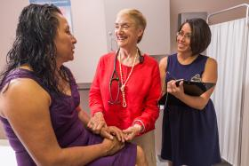 Georgina Castellan, left, visits with Elizabeth Magenheimer and Mari Montosa at Fair Haven.