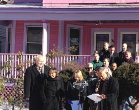 Mayor Pedro Segarra stands with city staff in front of a recently revamped home.