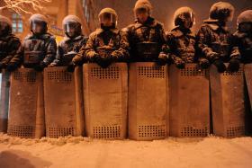 A line of riot police under heavy snow in Kiev on December 9, 2013.