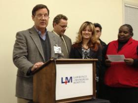 Hospital CEO Bruce Cummings addresses a joint press conference with union leaders Monday evening.