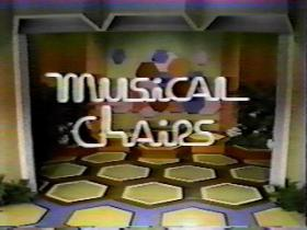 """The title shot of the CBS game show, """"Musical Chairs,"""" hosted by Adam Wade."""