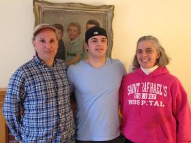 Justin, Tim and Mary Harmon in their Guilford home.