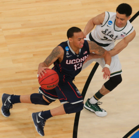 Shabazz Napier (13) of the UConn Huskies drives to the basket against Michigan State Spartans guard Travis Trice (20) during the NCAA men's tournament at Madison Square Garden.