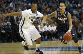 Connecticut Huskies guard Shabazz Napier (13) drives past Villanova Wildcats guard Tony Chennault (5) in their NCAA tournament game on Saturday.