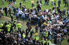 Police in the U.K. break up a clash between soccer fans. Unlike in the rest of the world, some U.S. fans become violent if their team wins.