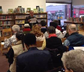 Jose B. Gonzalez recites a poem at the Park Street Library Branch in Hartford.