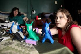 Rebekah Vincent, 12, of Wallingford, displays creatures that she made by hand. Kimberly, her mother, looks on.
