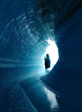 This ice cave in Belcher Glacier, Devon Island, Canada, was formed by melt water flowing within the glacier ice.
