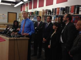 U.S. Education Arne Duncan speaks to reporters.