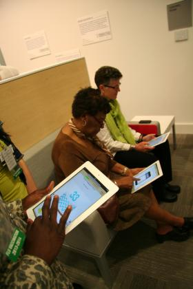 Instead of a waiting room where patients sit and watch TV, the Primary Care Office of the Future Exhibit has iPads where patients can fill out health information while they wait. The software is created by former videogame designers, with the hope of making the task of filling out forms less of a chore.