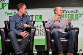 Lyft co-founders John Zimmer, at left, and Logan Green at TechCrunch Disrupt in September 2013.