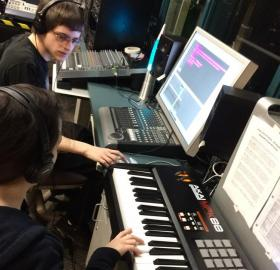 Students Duncan Bennett and Jacquelyn Humphrey work on sound production.