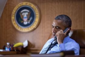 President Barack Obama talks on the phone aboard Air Force One with President Petro Poroshenko of Ukraine about the Malaysia Airlines plane crash in eastern Ukraine on July 17.