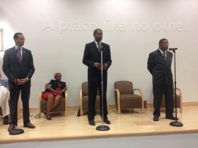 Shawn Wooden, Sen. Eric Coleman, and Len Walker at a recent debate.