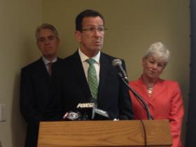Gov. Dannel Malloy discusses new data on rates of people without health insurance in the state.