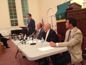 Malloy and area police chiefs speak at a forum at Hartford's Faith Congregational Church on Friday.