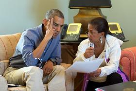 President Barack Obama talks with National Security Advisor Susan E. Rice following foreign leader phone calls, from Chilmark, Mass.