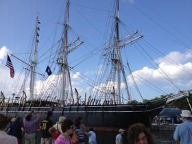 A crowd greets the Morgan as she returns to the Mystic Seaport.