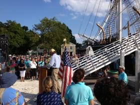 Captain Kip Files addresses the crowd after the Morgan docks at Mystic Seaport.