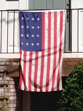 The flag the people of Stonington defended in 1814 was sewn by the women of the Congregational Church, with 16 stars and 16 stripes, a design never authorized by Congress.