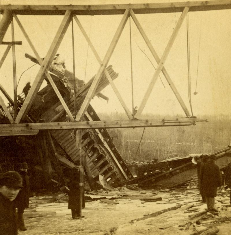 Note the massive timbers and long iron rods used in this wooden Howe truss bridge. Detail of stereograph by Daniel S. Camp of Hartford.