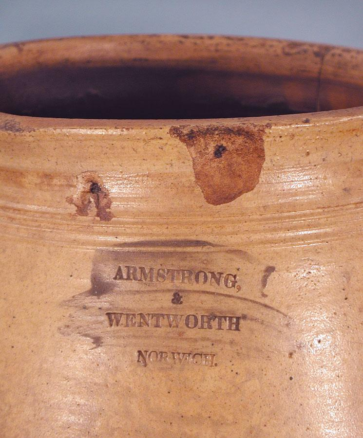 Detail of Salt-glazed stoneware jar. Made by Armstrong and Wentworth, 1814-1834. This detail shows the maker's mark stamped in the clay before it was fired.