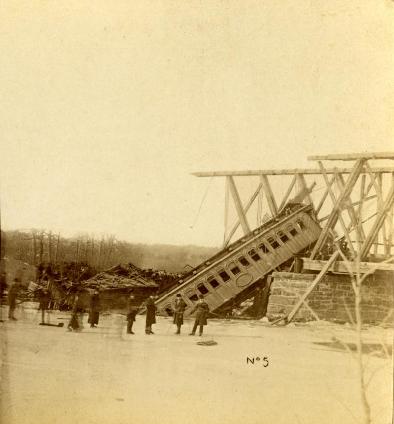 One of the coaches of the CWRR train hangs from the end of the first span over the Farmington River. Detail of stereograph published by N. R. Worden of New Britain.