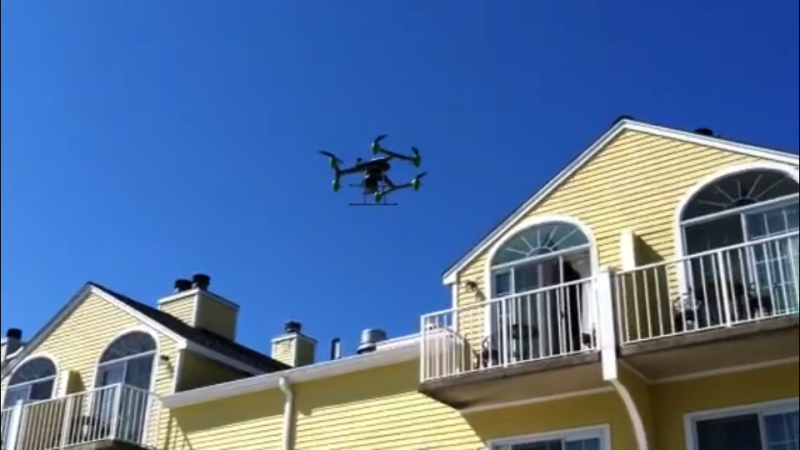 A StillFly drone in the air over the Saybrook Point Inn