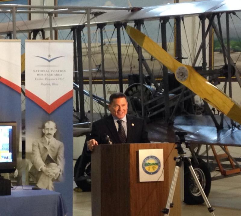 With Wright Flyer in background, Ohio State Rep. Rick Perales held a press conference on Thursday challenging Connecticut's law that replaces the Wright brothers with Gustave Whitehead as the first in powered flight.