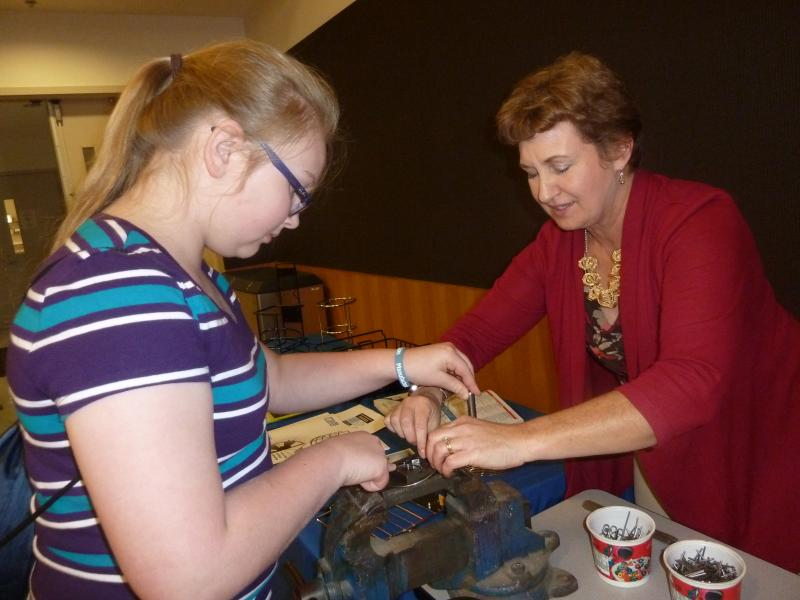 Maria Leise of Lisbon Central School is learning to make a wire bracelet from Mary Fitzgerald, president of Acme Wire Products Co. in Mystic.