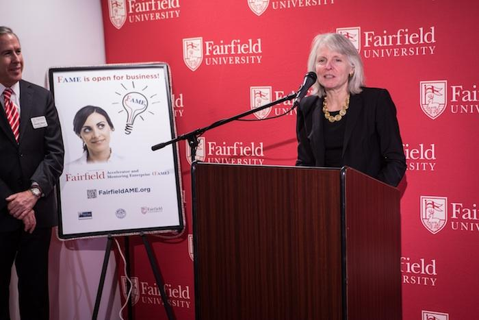 Catherine Smith, Commissioner of the Connecticut Department of Economic and Community Development, at the opening event of a business incubator at Fairfield University. At left is Donald E. Gibson, Ph.D., dean of the Dolan School of Business.