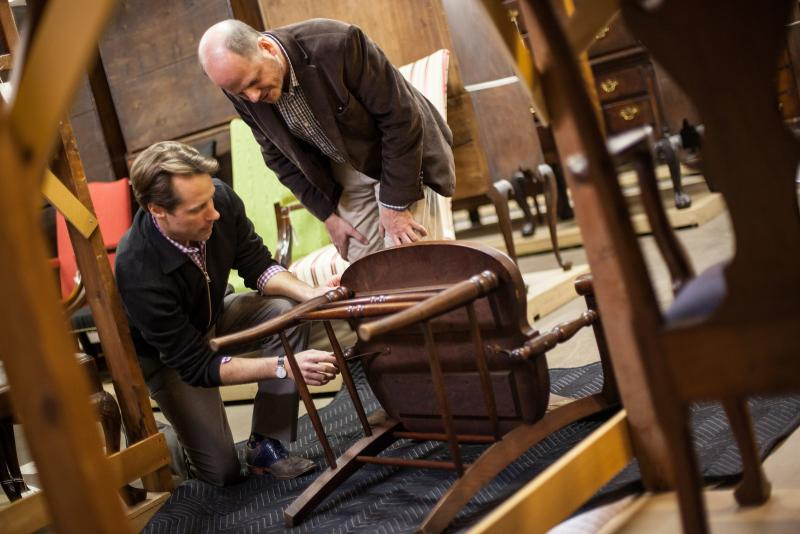 John Stuart Gordon, left, and Mark Branch examine William Taft's custom-made chair. Courtesy Yale University Art Gallery.
