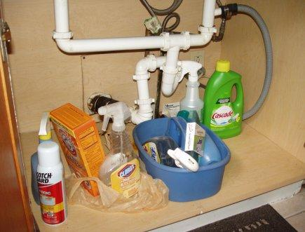 Household cleaners in a cabinet beneath the kitchen sink that are accessible to children.