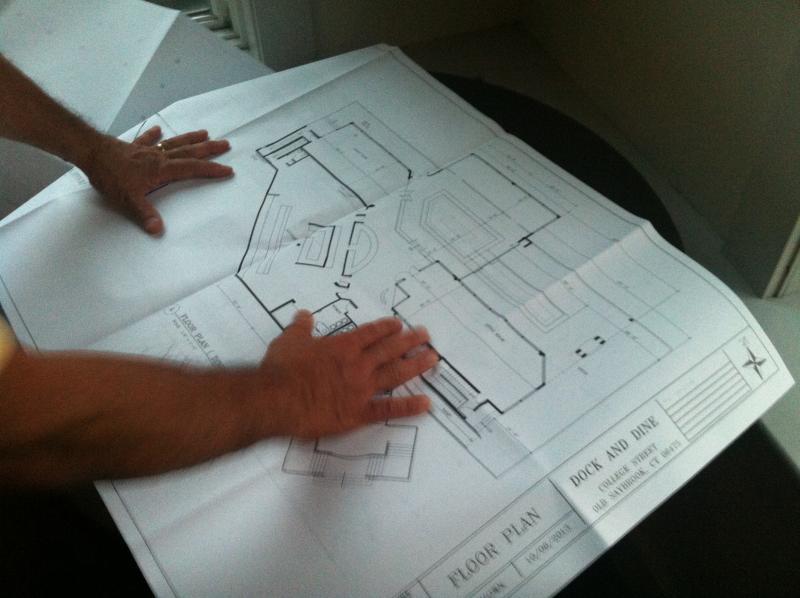 John Kodama shows plans for the new Dock & Dine.