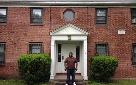 Dwayne Patterson stands outside his apartment building at Bowles Park in Hartford.