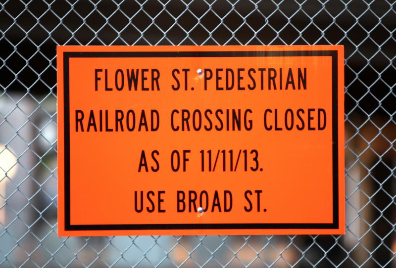 Sign at the Flower Street fence.