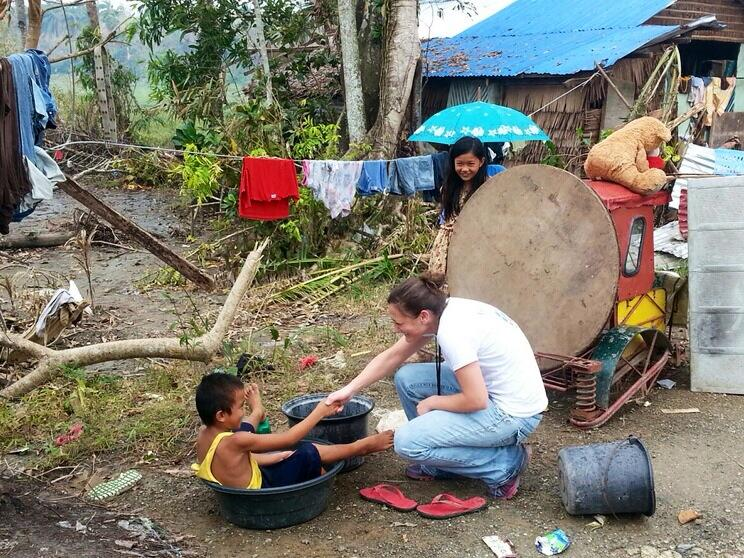 Americares' Emergency Response Manager Kate Dischino greeting a child in Samar Province. Dischino says she is amazed at the resiliency of the Philipine people in the aftermath of Typhoon Haiyan.