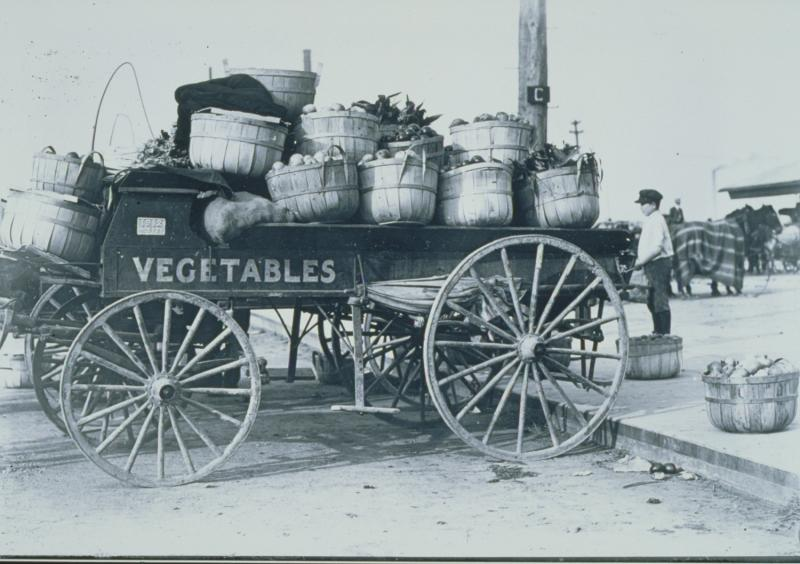 Vegetable cart in Charles Street Market, Hartford.  Photograph, 1912.  Many Italian immigrants were market gardeners, who brought produce into Hartford to sell.  The Connecticut Historical Society, 1982.61.1246