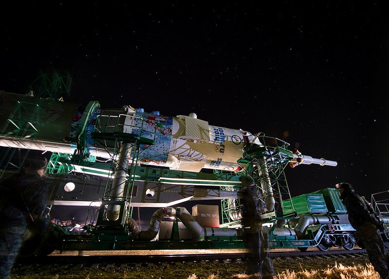 The Soyuz TMA-11M rocket, adorned with the logo of the Sochi Olympic Organizing Committee and other related artwork, is rolled out to the launch pad by train on Tuesday, Nov. 5, 2013, at the Baikonur Cosmodrome in Kazakhstan.