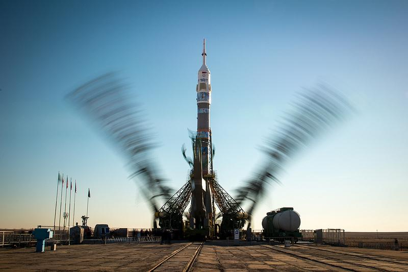 The Soyuz TMA-11M rocket, adorned with the logo of the Sochi Olympic Organizing Committee and other related artwork, is seen in this long exposure photograph, as the service structure arms are raised into position at the launch pad on Tuesday, Nov. 5.