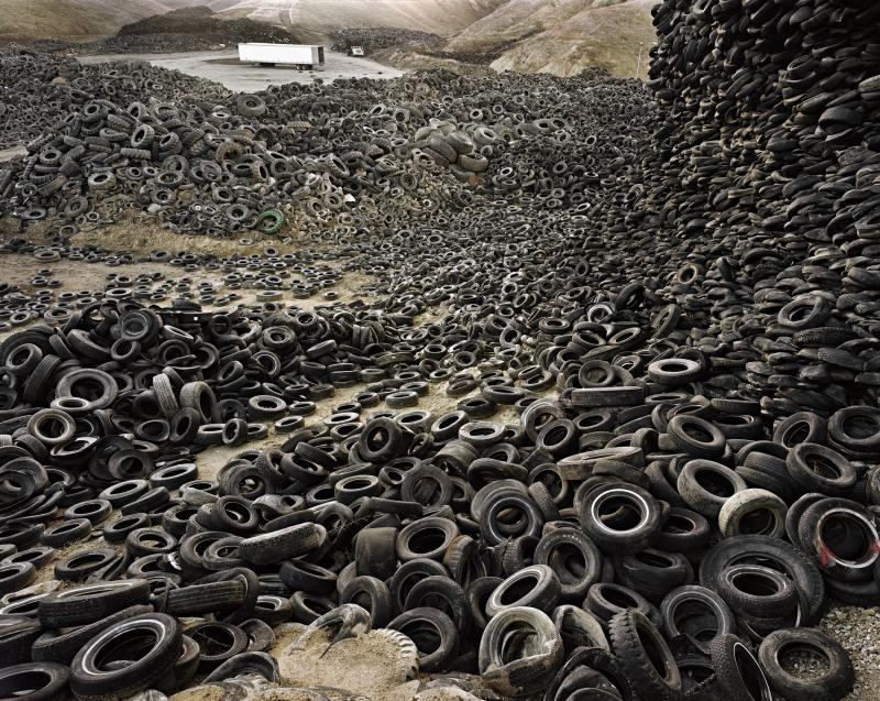 "Edward Burtynsky's ""Oxford Tire Pile #1,"" taken in Westley, Calif. in 1999, is one of the centerpieces of ""An Artificial Wilderness,"" which runs through Feb. 23 at the Wadsworth Atheneum in Hartford."