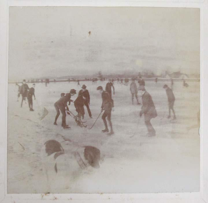 Boys Playing Hockey, ca. 1896.  This souvenir paperweight from the Connecticut State Building at the 1893 Columbian Exposition shows boys playing hockey on the old Garden Street Reservoir in Hartford.