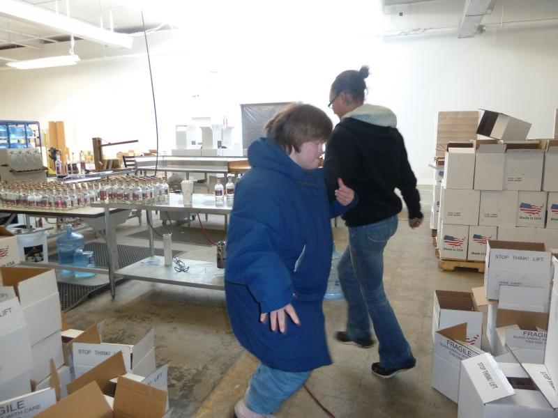 Eryka Wright, production manager, takes a dance break with employee Allison Cornelius.
