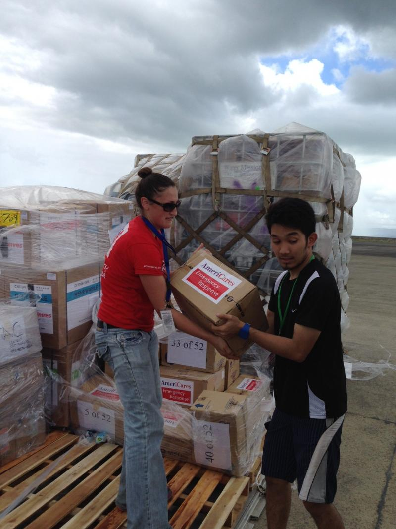 Kate Dischino helps unload medical supplies for a hospital in Tacloban