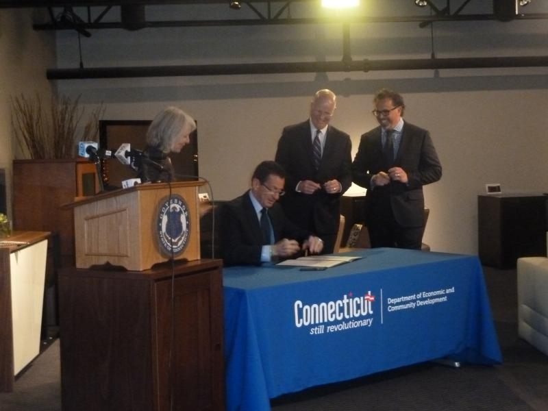 Governor Dannel Malloy signed a new executive order to increase transparency in state investments to promote economic development.