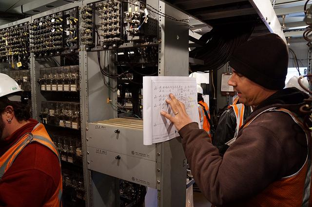 Metro-North Signal Department workers consult circuit diagrams, make signal changes and test the system at Spuyten Duyvil.