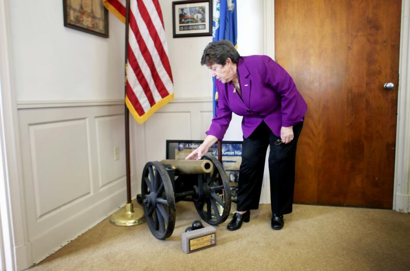 Commissioner Schwartz shows off the Civil War cannon in her office