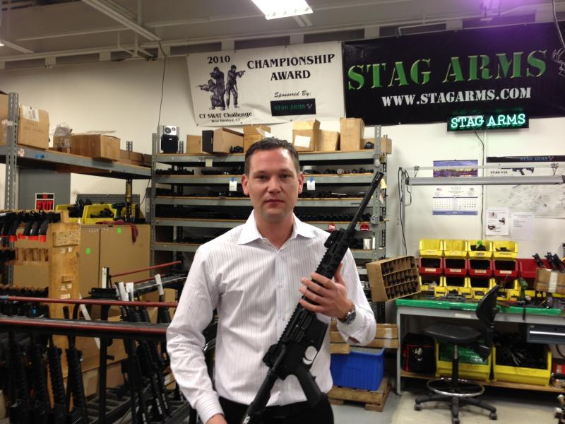Mark Malkowski with one of the weapons his company, Stag Arms, makes in New Britain