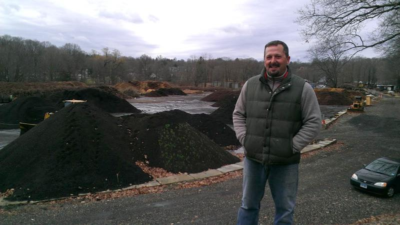 Jeff Demers stands on a hill overlooking New England Compost in Danbury, one of three licensed food residual composting facilities in the state. A new law aims to increase that number by targeting large-scale food waste generators.